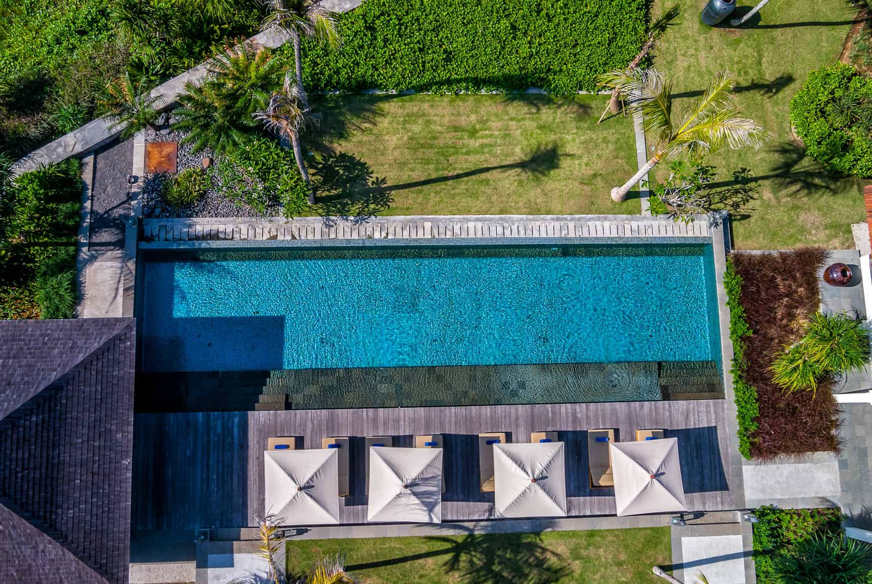 Pool, gardens, beach, and main property layout views